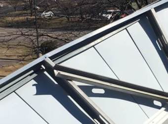storm damage repair for a commercial roof in Minneapolis, Minnesota